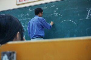 Teacher in blue shirt
